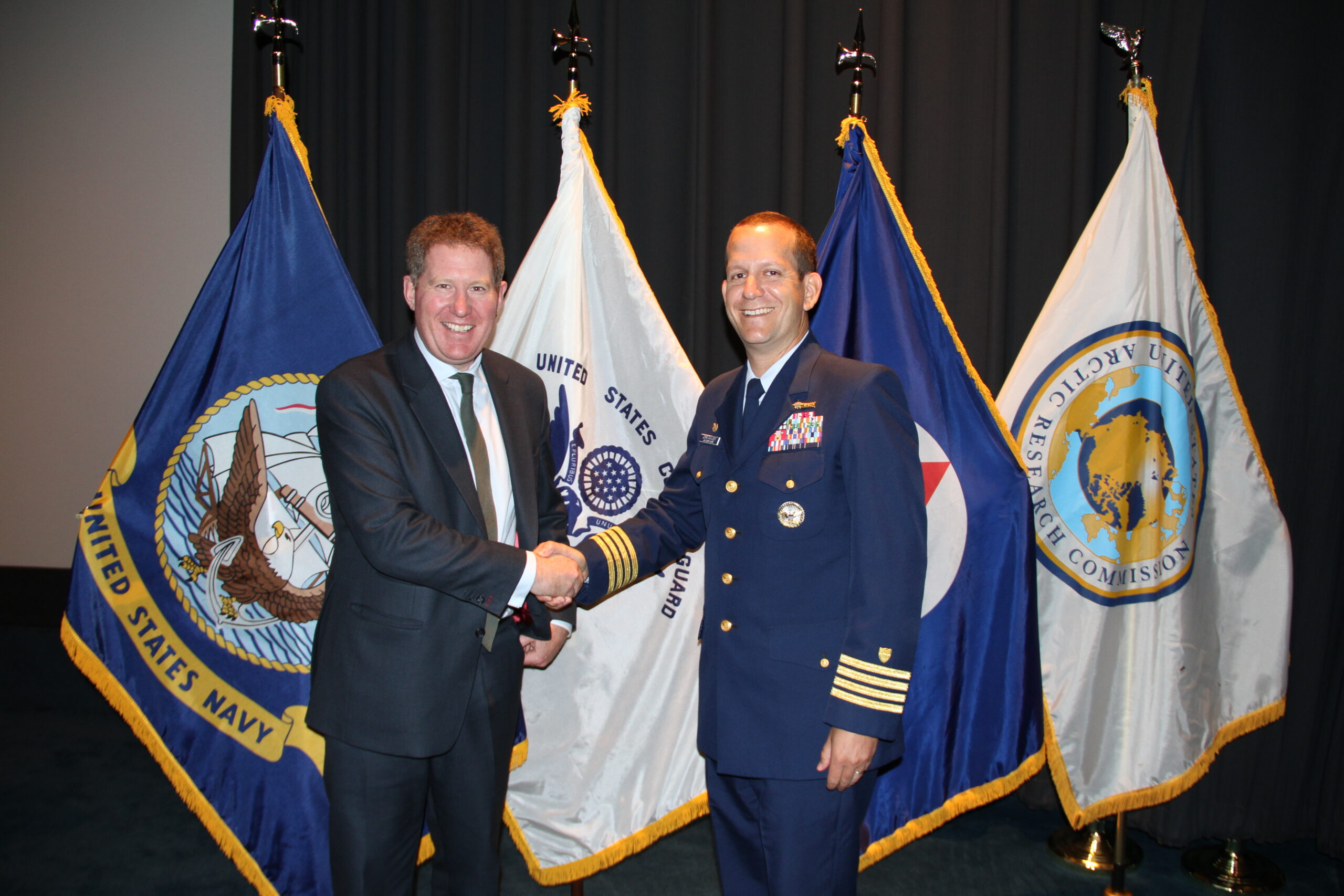 Receiving Challenge Coin Award. Washington D.C May 2015 from Captain John Mauger. Commanding Officer USCG Maritime Safety Centre HQ.